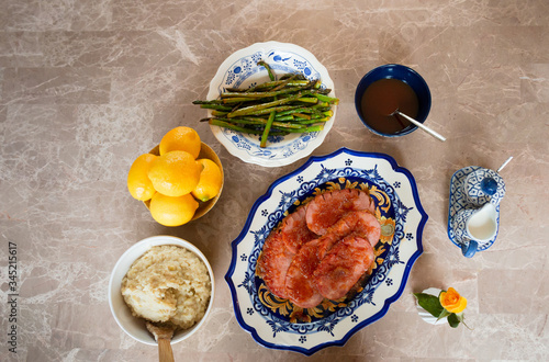 Turkey Ham Dinner Served on Blue and Yellow Dishes