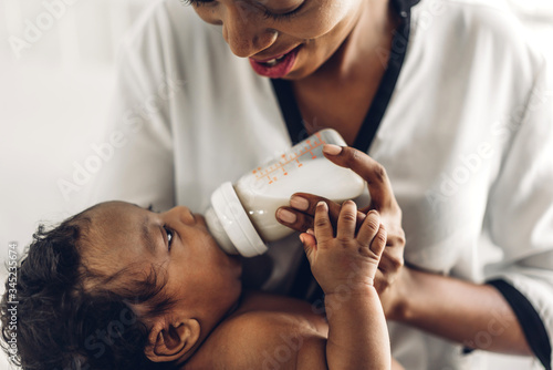 Fototapeta Portrait of enjoy happy love family african american mother playing with adorable little african american  concept obraz