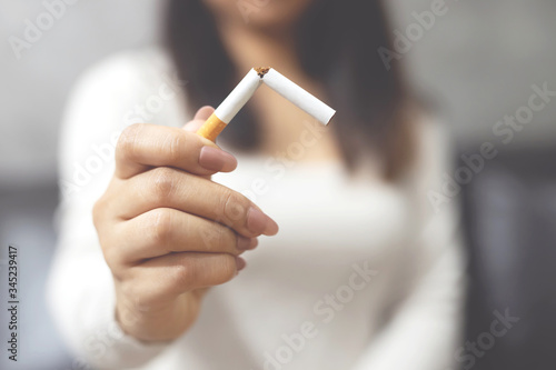 Fotografija woman refusing cigarettes concept for quitting smoking and healthy lifestyle
