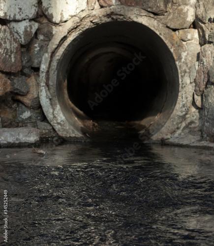 Fényképezés Run-off pipe discharging water