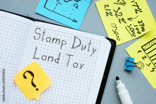 Foto Business concept about Stamp Duty Land Tax SDLT with phrase on the sheet