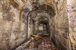 Underground abandoned iron ore mine tunnel with concrete timbering