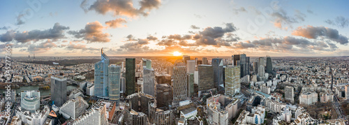 Aerial panoramic drone shot of La Defense skycraper in Paris CBD skyscraper complex business district with clouds during sunset