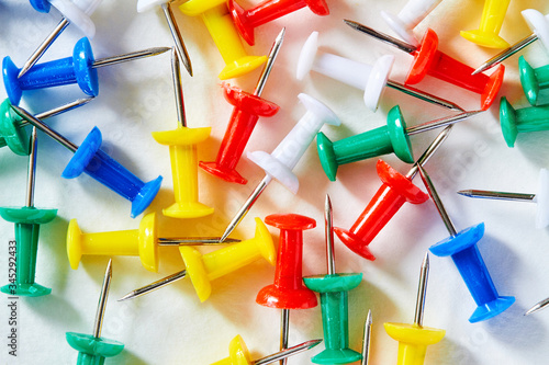 Сolored stationery buttons laid out on light background Canvas Print