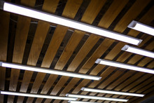Wooden Ceiling With Long White...