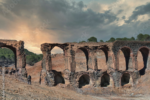 Sunset landscape with an old ruined aqueduct Wallpaper Mural
