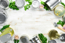 Canned Food In Tin Jars On Whi...