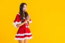 Portrait Beautiful Young Asian Woman Wear Christmas Clothes And Hat With Headphone