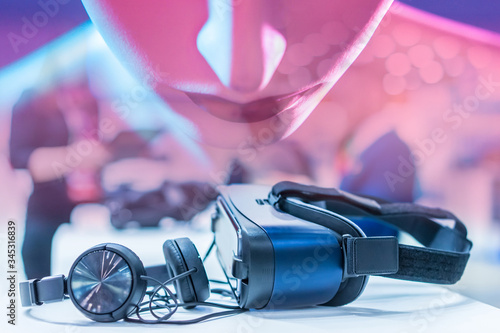 Photo Glasses for virtual reality next to the headphones