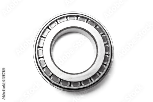 Photo Single row tapered roller bearing made of shiny metal is designed to absorb radial and one-sided axial loads of a vehicle