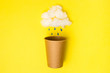 Leinwandbild Motiv Open Craft paper cup with cotton wool cloud and paper drops on a yellow background. Flat lay. Creative Minimal food or wather concept. Copy space, drink cup package mockup, rain time