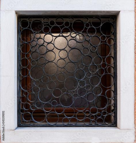 Obraz na plátne Window with decorative security bars