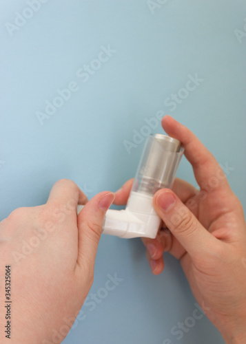 World Asthma Day May 5.anti-asthma inhaler on a blue background Fototapeta