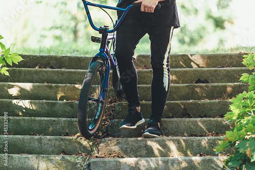 Photo Legs of a man and BMX close-up