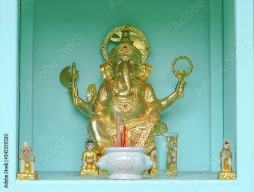Fototapeta Golden color of Ganesh and offering