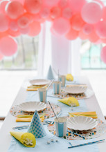 Decorative Festive Table Setting For Kids Party Dinner With Textile Napkin And Tablecloth In Sky Blue And Yellow Colors . Pink Balloons Decoration