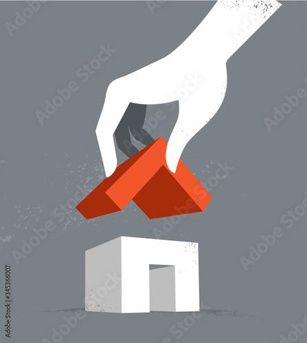 Valokuva La mano che completa l'edificio mettendo il tetto sopra