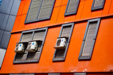 A Facade Of An Office Building With Ac Vents On The Outside