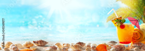Fototapeta Beautiful sand beach background with summer drink and seashells on the seashore. Copy space for text. obraz