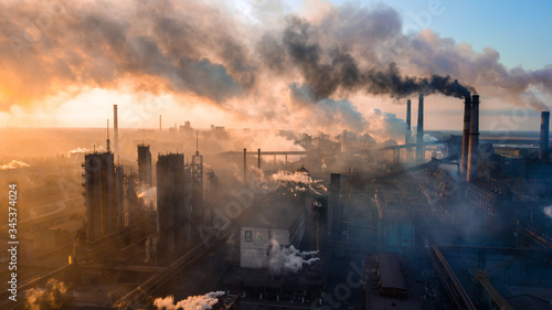 Fototapeta industry metallurgical plant dawn smoke smog emissions bad ecology aerial photography obraz