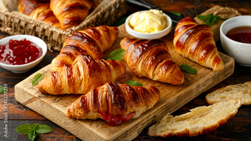 Cuadros en Lienzo Freshly baked croissants with butter, strawberry jam and tea for breakfast or br