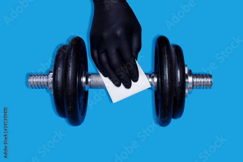 Cuadros en Lienzo Coronavirus COVID-19 Prevention in Gym Cleaning Sport Equipment Dumbell with Antibacterial Disinfecting Wipe Against Virus