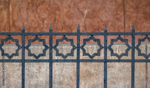 Eight pointed stars on a metal railings Wallpaper Mural