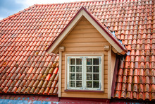 Red Tiled Roofs Of Old City. Tallinn Estonia. Summer Sunny Day. View From Above. Roof Window