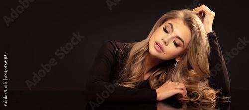 Fotografija Elegant woman with long wavy hair.
