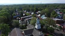 Aerial Views Of McMurrin Hall And Downtown Shepherdstown, WV As Camera Backs Away.