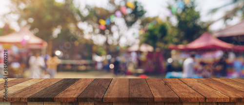 Fotografie, Obraz Empty wood table and defocused bokeh and blur background of garden trees in sunlight, display montage for product