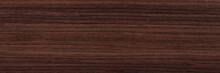 Contrast Rosewood Veneer Background In Dark Color. Natural Wood Texture, Pattern Of A Long Veneer Sheet, Plank.