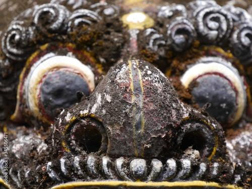 Close up of eyes of Balinese statue in Pura Sangara sea temple near Sanur, Bali Canvas Print