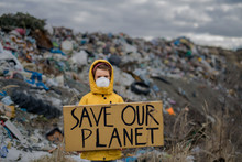 Small Child Holding Placard Poster On Landfill, Environmental Pollution Concept.