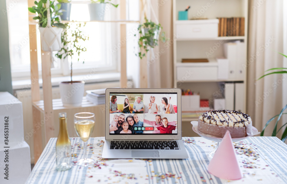 Fototapeta Laptop on table indoors, family chat and distance birthday celebration.