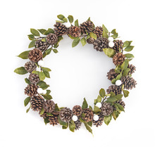 Top View Of Wreath With Copy Space. Winter Holidays And Christmas Celebration Concept. Christmas Wreath Of White Balls, Laurel, Bay Leves And Pine Cones Are Isolated On White In Flatlay Style.