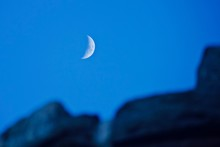 Low Angle View Of Moon Against...