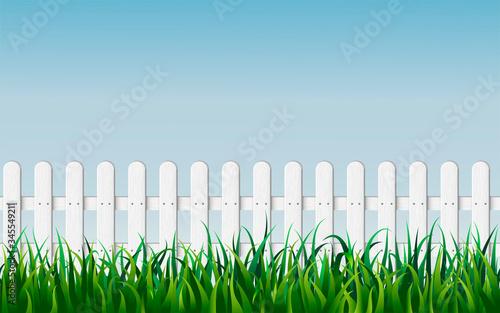 Obraz na plátne seamless white fence with green grass on blue sky background