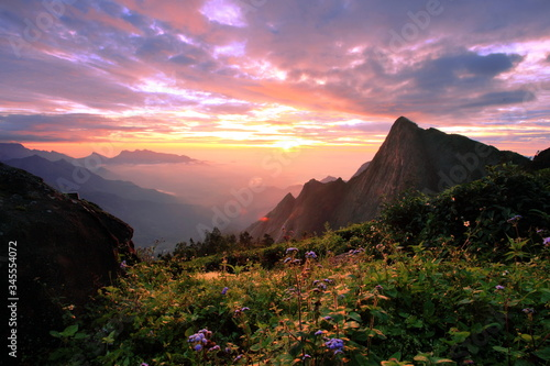 Scenic View Of Mountains Against Cloudy Sky At Sunrise - fototapety na wymiar