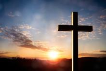 Crucifix Cross At Sunset Backg...