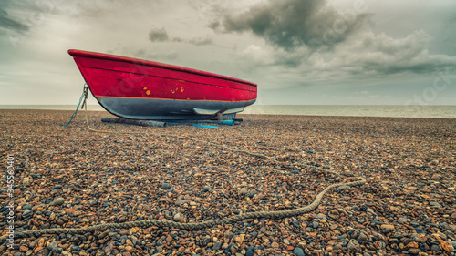Red Boat Moored On Beach Against Sky Wallpaper Mural