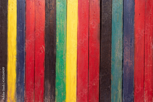 Fototapeta background of multi colored rough boards, red, black, yellow, blue, green