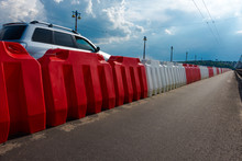 Plastic Road Barriers Filled With Red And White Water