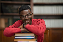 African Student On Pile Of Books