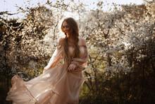 Beautiful Girl In Flowering Tr...