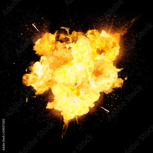 Foto Fiery bomb explosion with sparks isolated on black background