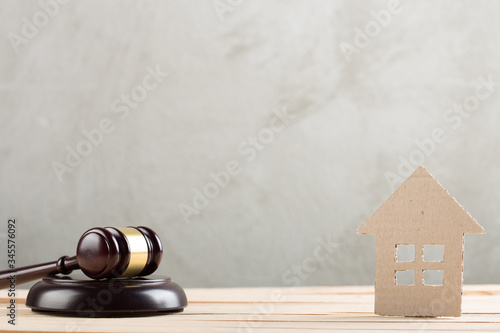 Real estate sale auction concept - gavel and house model Canvas Print