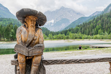 Wooden Reading Dwarf At Lake Jasna In Slovenia