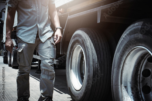 Cuadros en Lienzo truck driver walking around a truck, checking safety vehicle a truck tires