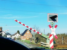 Railroad Crossing Sign Against Blue Sky